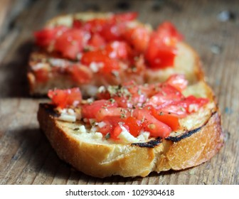 closeup with delicious looking bruschetta on a wooden support