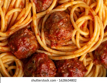 Close-up of delicious meatballs pasta with tomato sauce, from above. Tasty homemade meatballs spaghetti concept, food pattern background