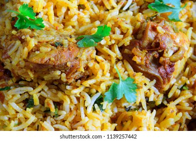 Close-up of delicious, tasty, spicy, lip smacking chicken biryani - an all India and Pakistani favorite meal with juicy, succulent chicken pieces in aromatic long grained Basmati rice.