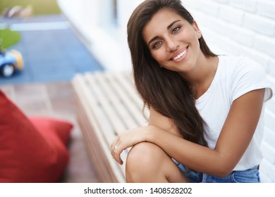 Close-up delighted tender feminine hispanic tanned girlfriend enjoy date sit rest outdoor bench park cafe tilting head joyfully smiling glance camera flirty happy, enjoy good summer walk
