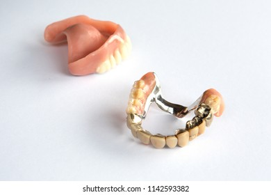 closeup of dental prosthesis on a white background
