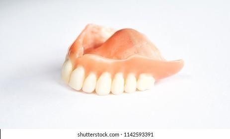 closeup of dental prosthesis on a white background