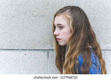 Close-up of depressed teenage girl.