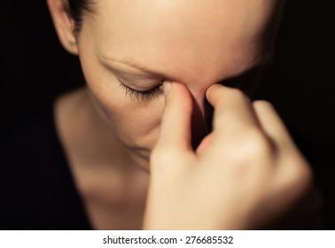Closeup of depressed woman.