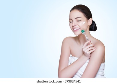 Close-up Derma Roller. Making Cosmetology Procedure with Roller on Woman's Face in the Cosmetology office, Natural Stimulation of Collagen and Elastin. Alternative to    injections. High definition