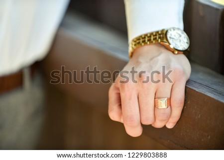 Closeup designer watch on businessman hand
