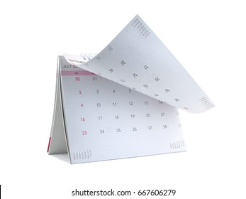 close-up desk calendar with days and dates in July 2017 and lines for note isolated on white background, flip the calendar page