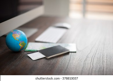 Closeup of the desk of a world traveler with a passport, plane tickets and a map. Photo with shallow depth of field