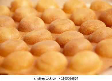 Close-up dessert Waffle Hong Kong or bubble waffle on wood background.