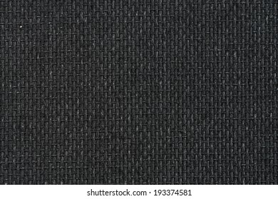 Closeup detail of background made of a black fabric texture
