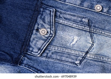 closeup detail of blue vintage denim jacket. Fashion, textures and backgrounds