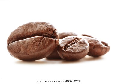 Close-up detail of coffee beans isolated on white background.