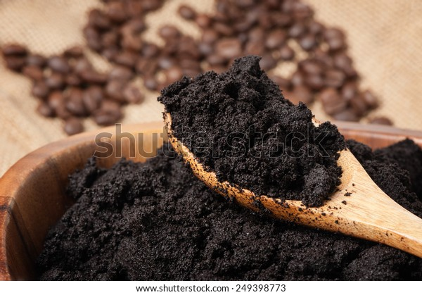 closeup detail of coffee ground in wooden bowl