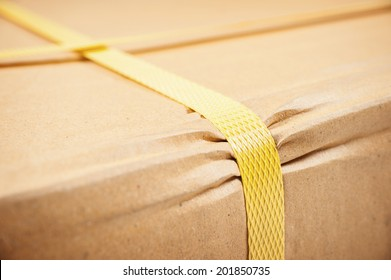 closeup detail of freight parcel with plastic strap