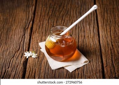 closeup detail of honey and honey dipper
