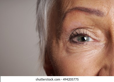 close-up detail of mature woman with green eyes