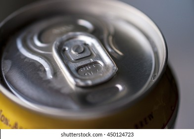Close-up detail of the metal can with beverage