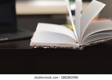 Close-up detail of an open study notebook on a table