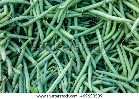 Closeup detail of organic green beans at an outdoor farmers market in Seattle.