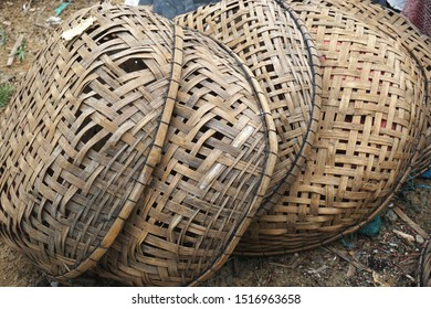 Closeup detail of pile of handwoven traditional bamboo baskets in rural Southeast Asia