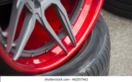 Closeup detail of Red Aluminum car wheel