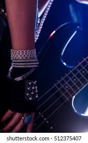 closeup detail of a rockstar player showy jewels