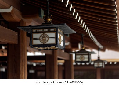 Close-up detail of roofs, lanterns, and interior architecture of a Buddhist temple in Tokyo, Japan