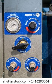 close-up detail of sandblaster control panel knobs and buttons