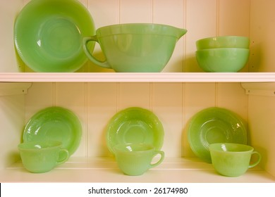Closeup detail of a set of green serving dishes for eating and drinking.