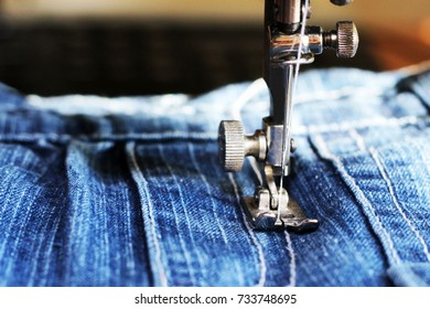Close-up detail of the sewing machine,blue jeans