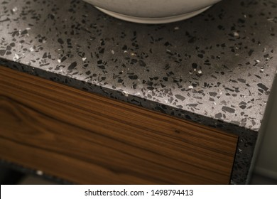 Closeup detail shot of gray terrazzo bathroom cabinet with black marble
