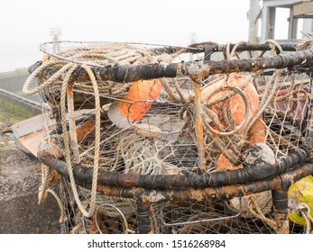 Closeup detail shot of stack of West Coast Crab Traps stacked up dockside. Commercial fishing concept.