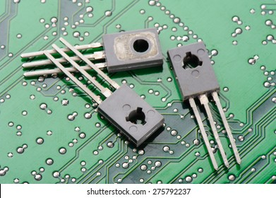 Closeup detail of transistors on circuit board