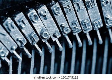 Close-up detail of typebars. Traditional typewriter letterpress arms.Detail of an old typewriter typebars.