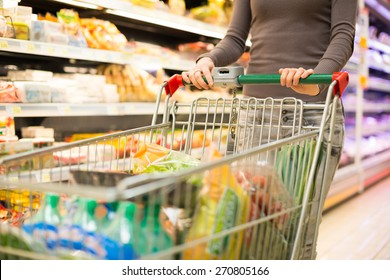 Closeup detail of a woman shopping in a supermarket