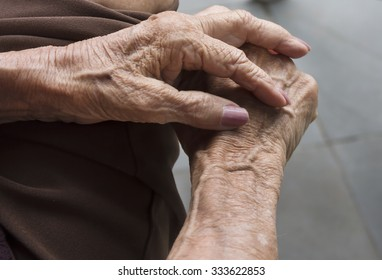 Closeup - detail wrinkled hands - elderly woman - taken from above