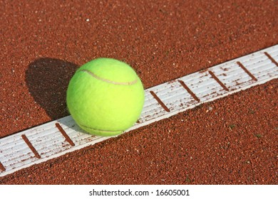 Close-up details of a tennis ball on the line (selective focus).