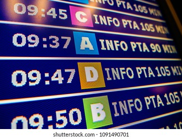 Close-up details of a typical airport information board with mutiple airlines hours departure gates and insignia for the boarding gate