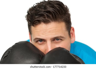 Close-up of a determined male boxer focused on his training over white background