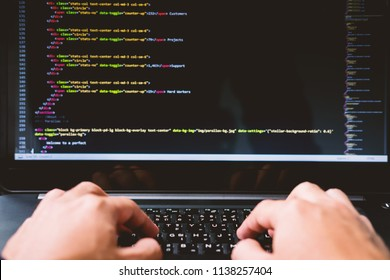 Closeup developing programming and coding technologies on desk white blurry screen, Website design, Programmer working in a software develop company office,Data processing center