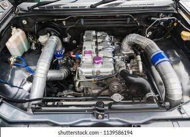 Close-up diesel engines racing.