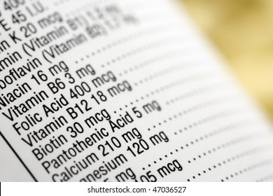 Closeup of a dietary supplement label listing the vitamins contained within each tablet. Horizontal shot.