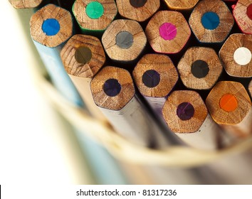closeup of different crayons on a white background