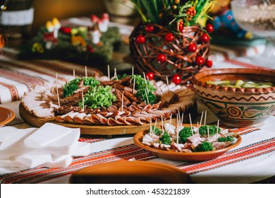 closeup different meat appetizer and snacks for dinner, catering serving on white plate