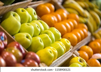 Close-up of different types of colorful fresh fruits in health grocery shop.