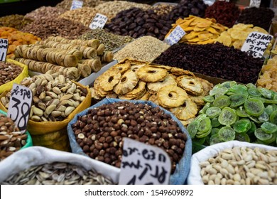 close-up of different types of dried fruit (pineapple, kiwifruit, figs) and nuts at the market, Israel, Jerusalem, Mahane Yehuda Market