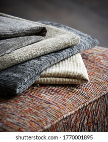 Close-up of different types of upholstery fabric on couch