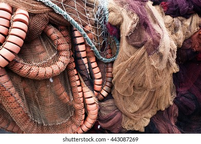 Close-up of different used old fishing nets and floats.