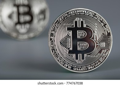 Closeup of digital asset -bitcoin. Gray background