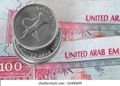 Closeup of dirham coins on notes